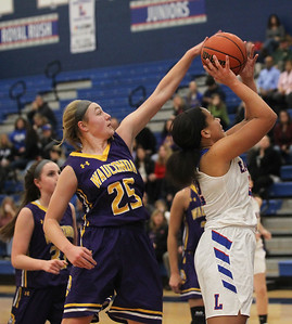 Candace H. Johnson-For Shaw Media Wauconda's Morgan Lung blocks a shot by Lakes Mia Edwards in the first quarter at Lakes Community High School in Lake Villa. Wauconda won 65-64. (12/4/18)