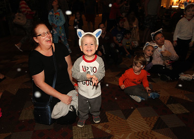 Candace H. Johnson-For Shaw Media Veronica Oglesby, of Laurel Ind., and her son, Sebastian, 2, enjoy falling snow in the grand lobby at the Great Wolf Lodge in Gurnee. Snow falls at 7, 8, and 9:00 pm. every day for the month of December. (12/1/18)