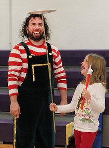 Candace H. Johnson-For Shaw Media Jason the Juggler watches Olivia Staruber, 6, of Lindenhurst volunteer to hold a plate spinning on a pole during the Light Up Your Holiday! Holiday Tree Lighting festivities at the Lindenhurst Park District's Lippert Community Center on Grass Lake Road. (12/1/18)