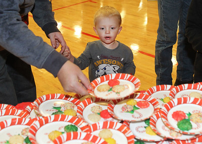 Candace H. Johnson-For Shaw Media Rory Richards, 2, of Lindenhurst holds his father, Lee's, hand while they pick out some cookies to eat during the Light Up Your Holiday! Holiday Tree Lighting festivities at the Lindenhurst Park District's Lippert Community Center on Grass Lake Road. (12/1/18)