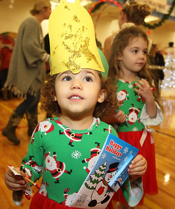 Candace H. Johnson-For Shaw Media Natalie Tutuianu, 3, of Lindenhurst holds on to her toy reindeer and holiday coloring book she received as she stands close to her sister, Emily, 5, during the Light Up Your Holiday! Holiday Tree Lighting festivities at the Lindenhurst Park District's Lippert Community Center on Grass Lake Road. (12/1/18)
