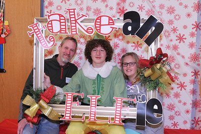 Candace H. Johnson-For Shaw Media Ethan Metzelaar, 17, as Buddy the Elf, (center) takes an Elfie with Ryan Brandes and his daughter, Abby, 10, all of Lindenhurst during the Light Up Your Holiday! Holiday Tree Lighting festivities at the Lindenhurst Park District's Lippert Community Center on Grass Lake Road. (12/1/18)