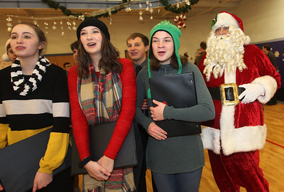 Candace H. Johnson-For Shaw Media Alex Lynch, 17, Meghan Hayman, 18, and Sam Drake, 15, all of Lindenhurst with the Lakes Community High School Chamber Choir sing Christmas carols as Santa joins in during the Light Up Your Holiday! Holiday Tree Lighting festivities at the Lindenhurst Park District's Lippert Community Center on Grass Lake Road. (12/1/18)
