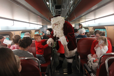 Candace H. Johnson-For Shaw Media Dylan Miller, 4, of Grayslake gets a candy cane from Santa as they ride in a Metra train during the Grayslake Park District's Polar Express Storytime Train event. (12/2/18)