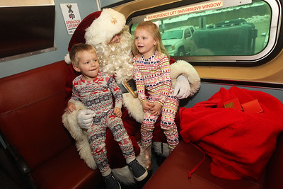 Candace H. Johnson-For Shaw Media Calvin Jones, 2, of Grayslake and his sister, Finley, 4, tell Santa what they want for Christmas as they ride a Metra train with him during the Grayslake Park District's Polar Express Storytime Train event. The siblings were also with their parents, Nathan and Leslie, and sister, Emerson, five-months-old.(12/2/18)