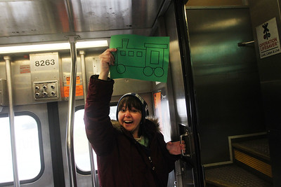Candace H. Johnson-For Shaw Media Amy Vagnoni, of Grayslake guides families into the right train car as they take the train to the North Pole (Fox Lake) to see Santa from the Grayslake Metra Station during the Grayslake Park District's Polar Express Storytime Train event. (12/2/18)