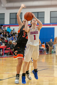 Dundee-Crown's Payton Schmidt goes up for the shot against McHenry Tuesday, December 11, 2018 in Carpentersville. Schmidt tied teammate Alyssa Crenshaw with 12 points as high scorers for the Chargers in the 42-35 win. KKoontz – For Shaw Media