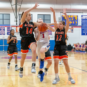 Dundee-Crown's Payton Schmidt splits McHenry defenders Jamie Howie (L) and Ashley Wachter (R) Tuesday, December 11, 2018 in Carpentersville. Schmidt tied teammate Alyssa Crenshaw with 12 points as high scorers for the Chargers in the 42-35 win. KKoontz – For Shaw Media