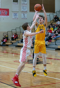 Crystal Lake South's Tyler Miller sinks a basket on his way to finishing with 18 points against Huntley Wednesday, December 12, 2018 in Huntley. Crystal Lake South picks up the road win 62-43 with Miller and teammate Matt Reall finishing as high scorers for the Gators. KKoontz – For Shaw Media