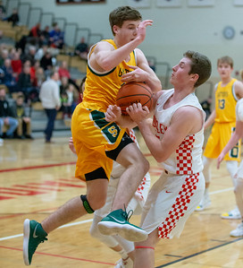 Crystal Lake South's Benjamin Geske drives the lane and collides with Huntley's Davis Pasco Wednesday, December 12, 2018 in Huntley. Crystal Lake South picks up the road win 62-43. KKoontz – For Shaw Media