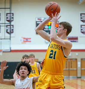 Crystal Lake South's Matt Reall sinks the jump shot in front of Huntley's Ryan Crosby Wednesday, December 12, 2018 in Huntley. Crystal Lake went on to win 62-43 with Reall and teammate Tyler Miller both finishing with 18 points each. KKoontz – For Shaw Media