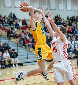 Crystal Lake South's Matt Reall passes the ball to an open player over Huntley's Davis Pasco Wednesday, December 12, 2018 in Huntley. Crystal Lake South picks up the road win 62-43. KKoontz – For Shaw Media