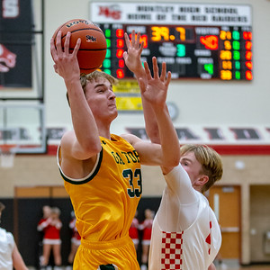 Crystal Lake South's Casey Haskin goes over Huntley's Nathan Draper for the shot Wednesday, December 12, 2018 in Huntley. Crystal Lake South picks up the road win 62-43. KKoontz – For Shaw Media