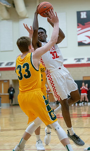 Huntley's Uchenna Egekeze is fouled by Crystal Lake South's Casey Haskin Wednesday, December 12, 2018 in Huntley. Egekeze led the Red Raiders with 11 points, but it wasn't enough as South picks up the road win 62-43. KKoontz – For Shaw Media