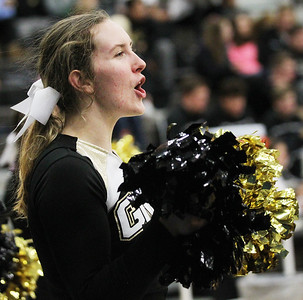 Candace H. Johnson-For Shaw Media Grayslake North's Abby Kicklighter, 18, cheers for the varsity boys basketball team as they play Deerfield in the fourth quarter at Grayslake North High School. Deerfield won 39-35. (12/10/18)