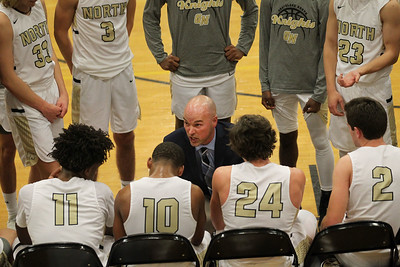 Candace H. Johnson-For Shaw Media Grayslake North's Todd Grunloh, head coach, talks to his varsity boys basketball players in a time-out against Deerfield in the fourth quarter at Grayslake North High School. Deerfield won 39-35. (12/10/18)