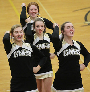 Candace H. Johnson-For Shaw Media Grayslake North cheerleaders Emily Huculak, 17, Kristina Merten, 15, Abby Kicklighter, 18, and Kaitlyn Klaszky, 15, (in back) cheer for the varsity boys basketball team as they play Deerfield in the third quarter at Grayslake North High School. Deerfield won 39-35. (12/10/18)