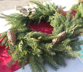 Candace H. Johnson-For Shaw Media A fresh holiday wreath was for sale in the Sol-ful blooms booth during the Grayslake Farmers Market on Center and Whitney Streets in downtown Grayslake. Next Saturday, December 15th, the market is open from 10-2 pm, the fall market's last day of the season. (12/8/18)