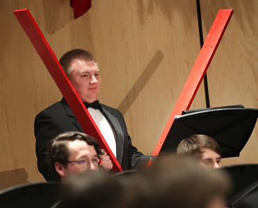 "Candace H. Johnson-For Shaw Media Michael Golebiowski uses a whip crack for the song, ""Sleigh Ride, "" as he performs with the Wind Ensemble during the Winter Concert at Lakes Community High School in Lake Villa. (12/11/18)"