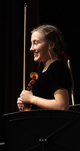 Candace H. Johnson-For Shaw Media Maddy Dunsworth stands as she holds her violin with the Symphony Orchestra after they performed during the Winter Concert at Lakes Community High School in Lake Villa. (12/11/18)