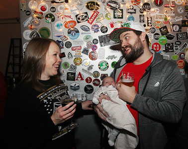 Candace H. Johnson-For Shaw Media Lindsay and Nick Krieschen, of Gurnee bring along their newborn daughter, Kayden, one-month-old, as they enjoy the Toy Drive & Pictures with Santa event at the Only Child Brewing Company Brewery & Taproom in Gurnee. (12/8/18)
