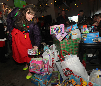 Candace H. Johnson-For Shaw Media Rachel Hewitt, of Waukegan drops off a toy during the Toy Drive & Pictures with Santa event at the Only Child Brewing Company Brewery & Taproom in Gurnee. (12/8/18)
