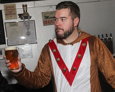 Candace H. Johnson-For Shaw Media Bartender Brett Widenhoefer, of Round Lake serves an IPA to a guest during the Toy Drive & Pictures with Santa event at the Only Child Brewing Company Brewery & Taproom in Gurnee. (12/8/18)
