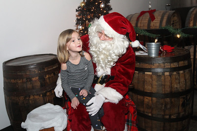 Candace H. Johnson-For Shaw Media Brooklyn Lackey, 5, of Lindenhurst talks to Santa during the Toy Drive & Pictures with Santa event at the Only Child Brewing Company Brewery & Taproom in Gurnee. (12/8/18)