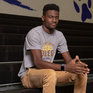 Former McHenry High School basketball player Maki Mohr poses for a photo before practice Thursday, December 13, 2018 at McHenry County College in Crystal Lake. Schools such as Illinois and DePaul showed interest in his skills on the track and in the high-jump, however Mohr decided to follow his dream of playing division one or two basketball. He now is honing his skills as a freshman at McHenry County College with hopes of one day attracting attention from a bigger school. KKoontz – For Shaw Media