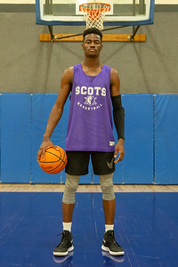 Former McHenry High School basketball player Maki Mohr poses for a photo before practice Thursday, December 13, 2018 at Commit Fitness in Woodstock. Schools such as Illinois and DePaul showed interest in his skills on the track and in the high-jump, however Mohr decided to follow his dream of playing division one or two basketball. He now is honing his skills as a freshman at McHenry County College with hopes of one day attracting attention from a bigger school. KKoontz – For Shaw Media