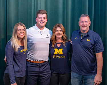 The Keegan family (L-R) Taylor, Trevor, Amanda, and Mike pose for a photo at Trevor's press conference Friday, December 14, 2018 in Crystal Lake. Trevor committed to play football for the University of Michigan after having received over 25 offers from division one schools. KKoontz – For Shaw Media