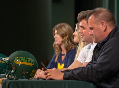 At the table with his family, Crystal Lake South offensive lineman Trevor Keegan answers questions at his college press announcement Friday, December 14, 2018 in Crystal Lake. The 6-foot-6 Keegan committed to play football for the Michigan Wolverines.   KKoontz – For Shaw Media