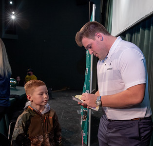 After his press conference in which he announced his intent to play football for the University of Michigan, Trevor Keegan signs an autograph for 9 year old Andrew Dawson Friday, December 14, 2018 in Crystal Lake.  KKoontz – For Shaw Media