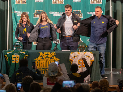 Crystal Lake South's Trevor Keegan along with family members (L-R) mother Amanda, sister Taylor, and his father Mike, revels that the University of Michigan is where he'll play college football Friday, December 14, 2018 in Crystal Lake. Keegan was the state's top-ranked recruit and had offers from more than 25 division one schools. KKoontz – For Shaw Media