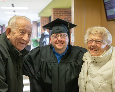 Josh Tillman (Center) along with grandparents Bob and Joy Shook celebrate Josh's graduation at the 2018 McHenry County College Winter Commencement ceremony Saturday, December 15, 2018 in Crystal Lake. Josh received his Associate degree in the Arts.   KKoontz – For Shaw Media