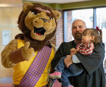 John Gehrke and daughter Summer pose for a photo with McHenry County College mascot Roary Saturday, December 15, 2018 at the 2018 McHenry County College Commencement ceremony in Crystal lake.  KKoontz – For Shaw Media