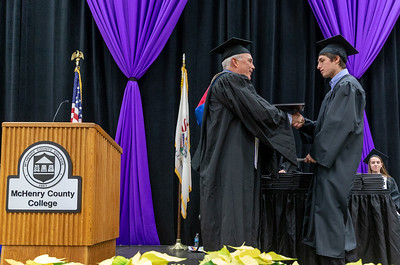 Zachary Lasso (right) receives his Associate degree in Automotive Technology, Management Option at the 2018 McHenry County College Winter Commencement ceremony Saturday, December 15, 2018 in Crystal Lake.   KKoontz – For Shaw Media