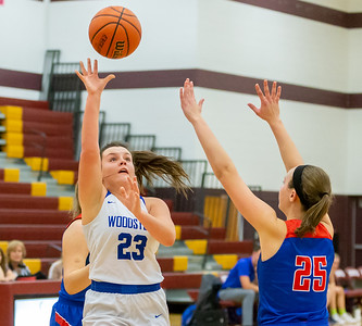 Woodstock's Kelsey Perkins pulls up and sinks a jump-shot over Lakes High School's Kylie Jozwik during the Northern Illinois Girls Holiday Classic Basketball Tournament held Tuesday, December 17, 2018 at Richmond –Burton High School in Richmond. Woodstock fell to Lakes 49-33. Perkins finished the night with 6 points for the Blue Streaks. KKoontz – For Shaw Media