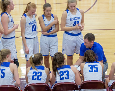 First year Woodstock Head Coach Collin Kalamatas talks to his team during a time-out at the Northern Illinois Girls Holiday Classic Basketball Tournament held Tuesday, December 17, 2018 at Richmond –Burton High School in Richmond. Woodstock fell to Lakes 49-33.  KKoontz – For Shaw Media
