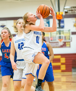 Woodstock's Juel Mecklenburg drives baseline for the shot against Lakes High School during the Northern Illinois Girls Holiday Classic Basketball Tournament held Tuesday, December 17, 2018 at Richmond –Burton High School in Richmond. Woodstock fell to Lakes 49-33. Mecklenburg led the Blue Streaks in scoring with 7 points. KKoontz – For Shaw Media
