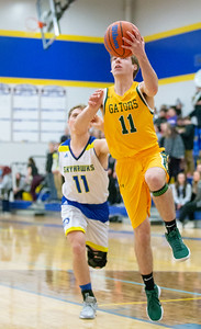 Crystal Lake South's Benjamin Geske goes in for the lay-up and the first points of the game against Johnsburg Tuesday, December 18, 2018 in Johnsburg. South went on to win big, 49-28. KKoontz – for Shaw Media