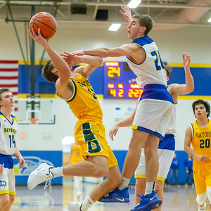 Crystal Lake South's Ryan Lawson draws the foul by Johnsburg's Gibson Groves in the third quarter Tuesday, December 18, 2018 in Johnsburg. Crystal Lake South takes the win 49-28. KKoontz – For Shaw Media