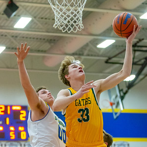 Crystal Lake South's Casey Haskin goes up for the shot against Johnsburg's Joey Comstock Tuesday, December 18, 2018 in Johnsburg. Crystal Lake South takes the win 49-28. KKoontz – For Shaw Media