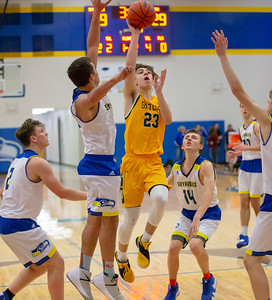 Crystal Lake South's Tyler Miller drives through the Johnsburg defense for the shot Tuesday, December 18, 2018 in Johnsburg. Crystal Lake South wins big 49-28. KKoontz – For Shaw Media