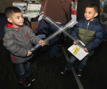 Candace H. Johnson-For Shaw Media Damian Reyes, 4, of Round Lake Park and his brother, Jayden, 5, has some fun with the light up toys they picked out during the P.L.A.N. Holiday Ham & Christmas Toy Give-a-Way in Round Lake Beach. (12/15/18)