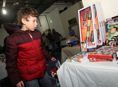 Candace H. Johnson-For Shaw Media Kamden Colon, 9, of Round Lake Beach looks at the toys he can pick out during the P.L.A.N. Holiday Ham & Christmas Toy Give-a-Way in Round Lake Beach. (12/15/18)