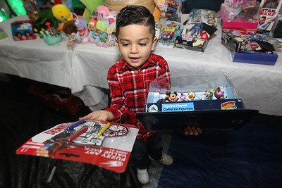 Candace H. Johnson-For Shaw Media Jason Rodriguez, 4, of Round Lake Beach shows off the toys he picked out during the P.L.A.N. Holiday Ham & Christmas Toy Give-a-Way  in Round Lake Beach. (12/15/18)