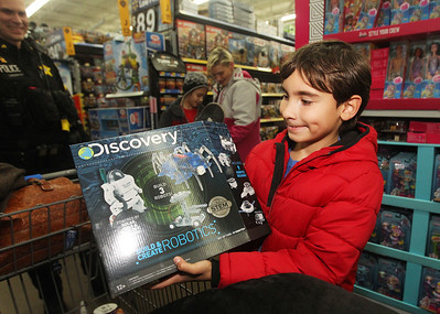 Candace H. Johnson-For Shaw Media Kayden Estes, 9, of Lindenhurst shows a Discovery Build & Create Robotics toy he picked out during Lake Villa's Shop with a Cop at Walmart in Round Lake Beach. (12/13/18)