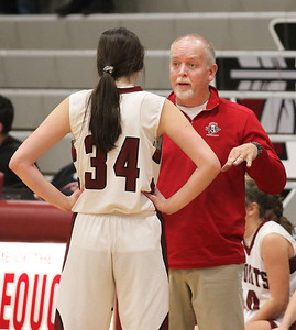Candace H. Johnson-For Shaw Media Antioch's Avery Larson takes a moment to talk with her coach, Tim Borries, as she plays with her basketball team against Zion-Benton in the fourth quarter at Antioch Community High School. Zion-Benton won 56-47. (12/17/18)