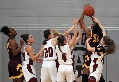 Candace H. Johnson-For Shaw Media Zion-Benton's Mary Brewer (#32) is surrounded by Antioch defenders as she tries to take a shot in the first quarter at Antioch Community High School. Zion-Benton won 56-47. (12/17/18)